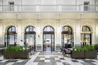 Housed in a restored 140-year-old state treasury building in the downtown area of Perth, Australia, Como The Treasury's 48 rooms and suites have high ceilings, cornicing, and balconies.