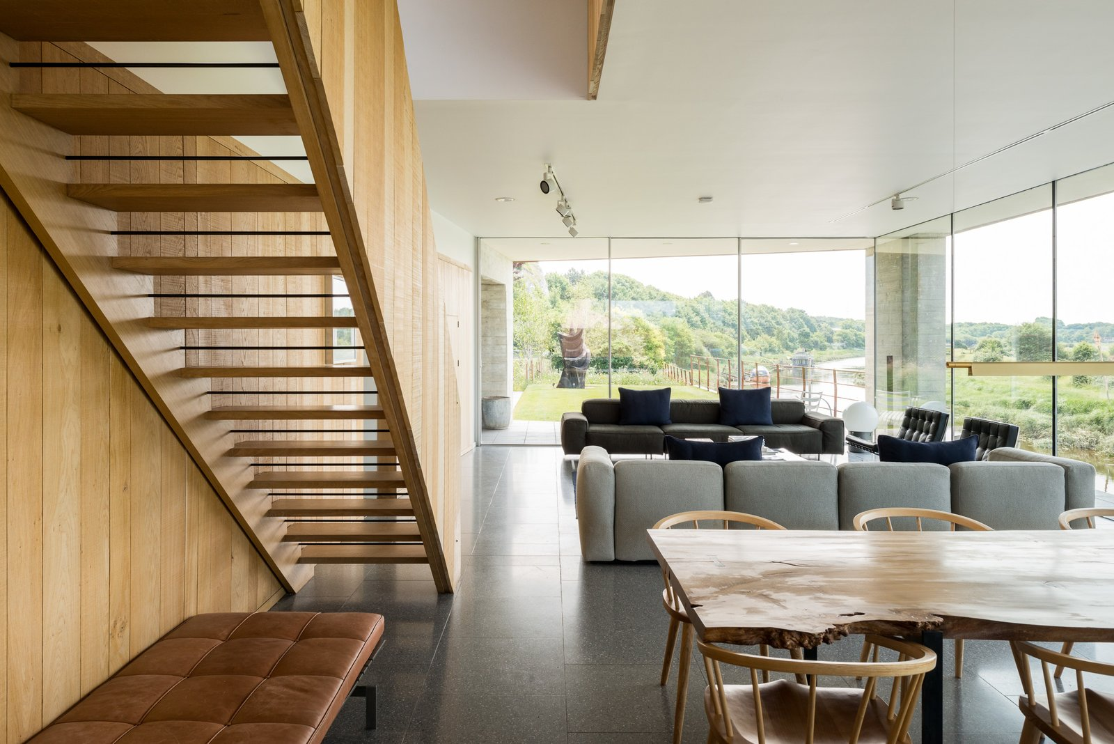 Staircase, Wood Tread, Wood Railing, and Metal Railing  Photo 12 of 12 in Explore a Prefabricated House For Sale in England That's Clad With Cor-Ten Steel