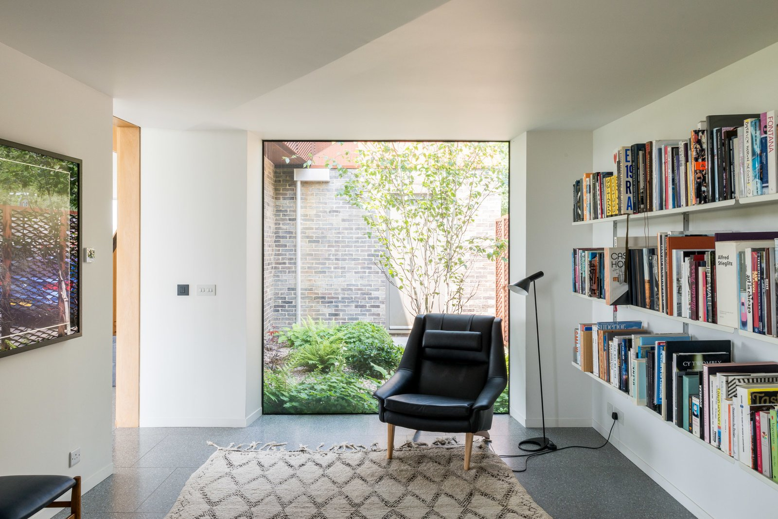 Office, Library Room Type, Chair, Lamps, and Terrazzo Floor  Photo 9 of 12 in Explore a Prefabricated House For Sale in England That's Clad With Cor-Ten Steel