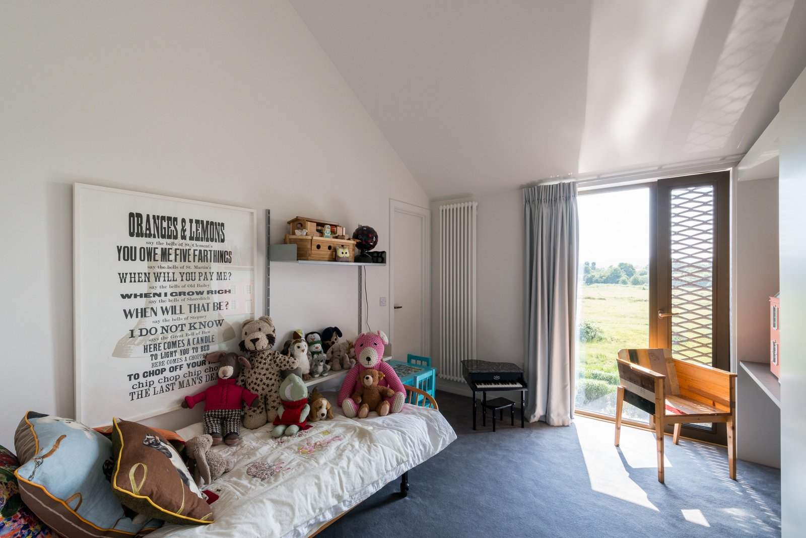 Kids Room, Bed, Bedroom Room Type, Shelves, Chair, Toddler Age, Neutral Gender, and Carpet Floor  Photo 11 of 12 in Explore a Prefabricated House For Sale in England That's Clad With Cor-Ten Steel
