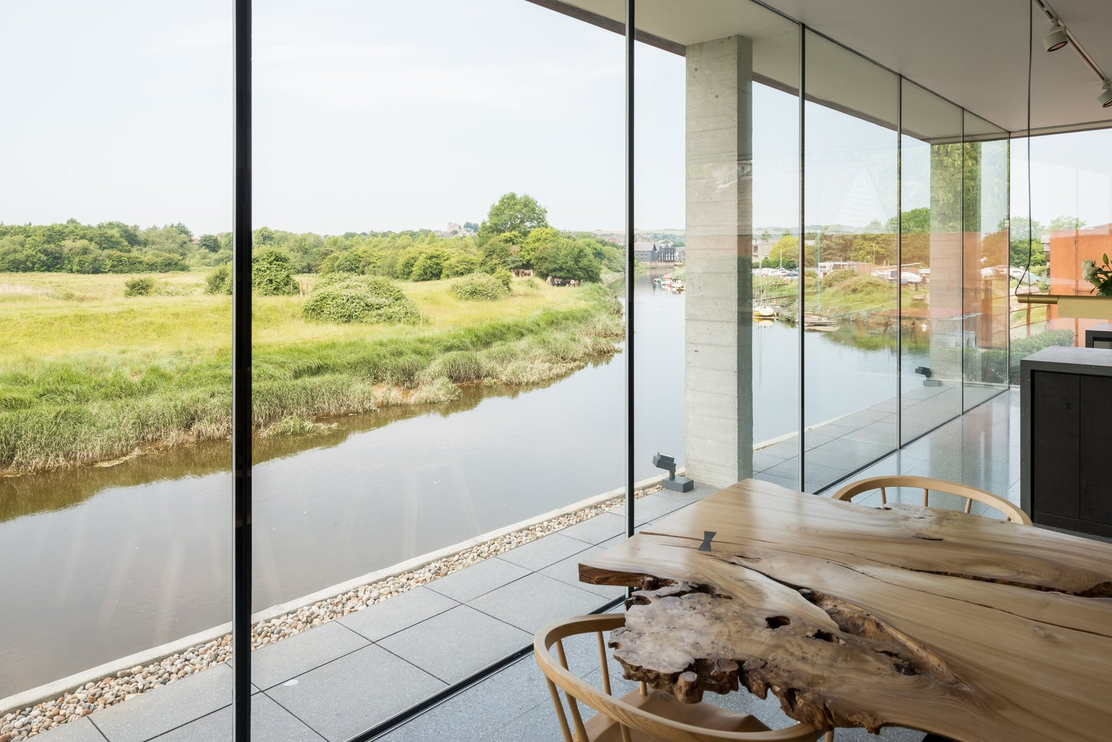 Windows Perched along the banks of the River Ouse near the historic English town of Lewes is a Cor-Ten steel house with a  Photo 7 of 12 in Explore a Prefabricated House For Sale in England That's Clad With Cor-Ten Steel from 50 Modern Homes With Floor-to-Ceiling Windows