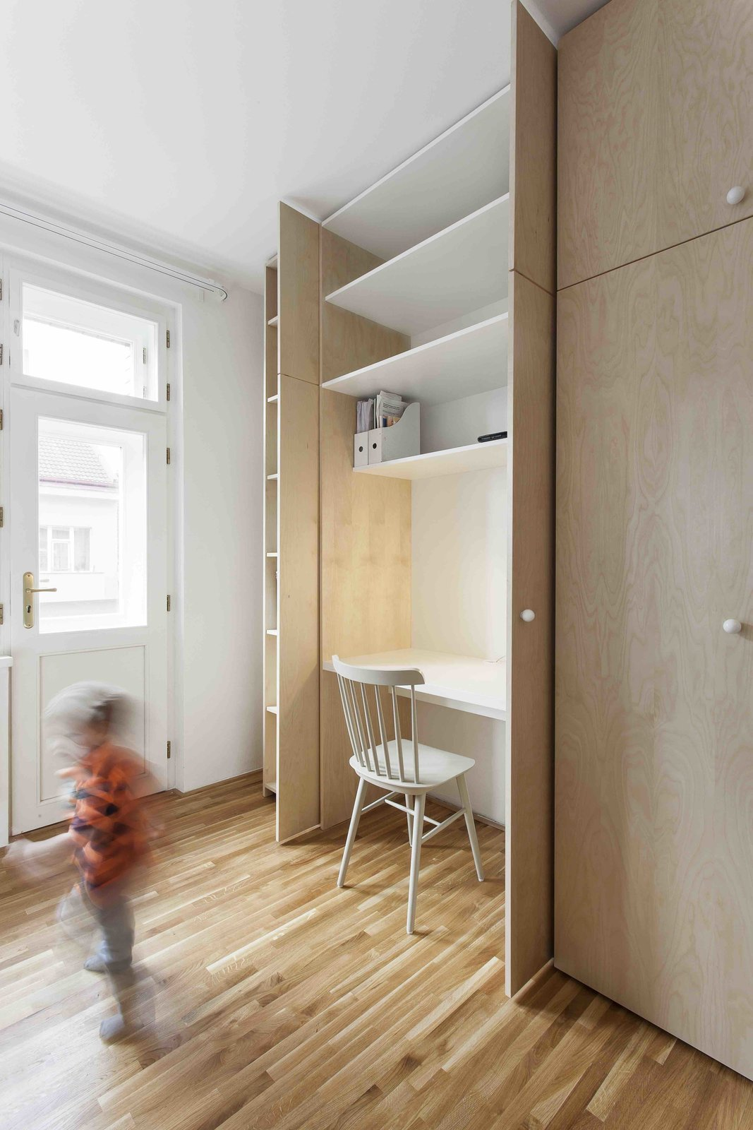 Storage Room, Closet Storage Type, and Shelves Storage Type  Photo 7 of 13 in A Family Apartment in Prague That's Filled With Clever Storage Solutions and Built-In Nooks