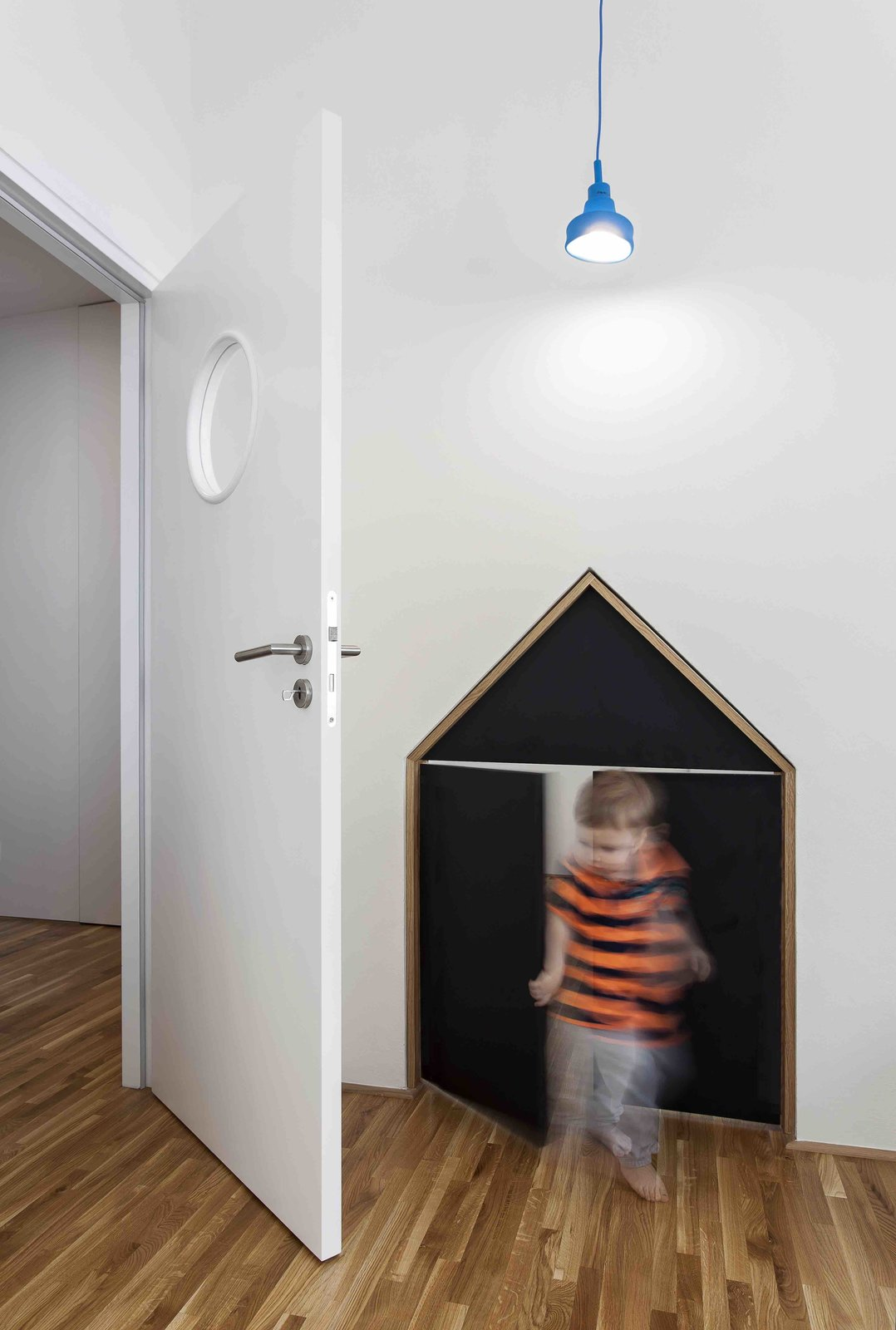 Kids, Medium Hardwood, and Toddler  Best Kids Toddler Medium Hardwood Photos from A Family Apartment in Prague That's Filled With Clever Storage Solutions and Built-In Nooks
