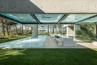 The Wall House in Cascais, a coastal town in an area known as the Portuguese Riviera, is an 11,840-square-foot home made with concrete, wood, and glass—and boasts a pair of large swimming pools on two levels. Designed by José Guedes Cruz, César Marques, and Marco Marinho of the Portugal-based firm Guedes Cruz Architects, The Wall House is laid out in an open-box plan, and is fitted with plenty of glass windows to enhance the synergy between its interior and exterior spaces.