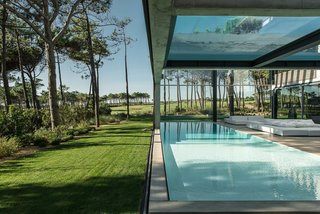 A Pool With a Glass Bottom Hovers Over Another at a House in the Portuguese Riviera - Photo 7 of 12 -