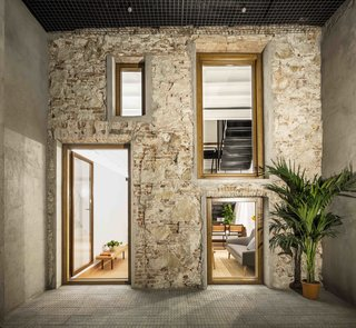 This Double-Height Apartment in   Barcelona Features Historic Details and a Floating Staircase - Photo 3 of 12 -