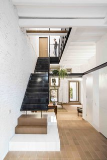 This Double-Height Apartment in   Barcelona Features Historic Details and a Floating Staircase - Photo 2 of 12 -