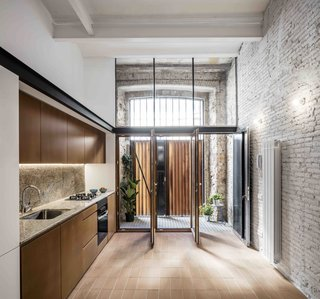 This Double-Height Apartment in   Barcelona Features Historic Details and a Floating Staircase - Photo 4 of 12 -