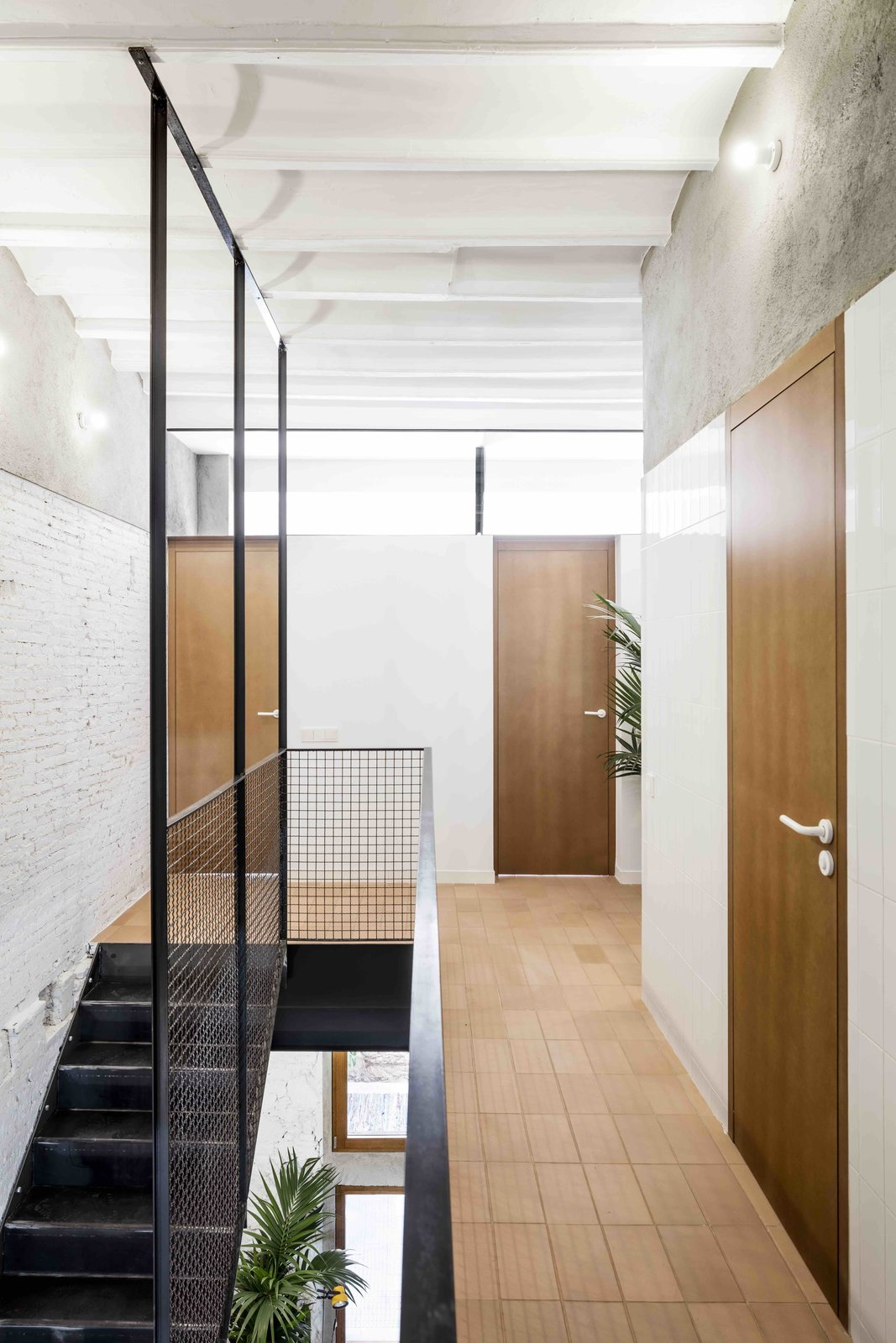 Staircase, Metal Railing, and Metal Tread  Photo 6 of 13 in This Double-Height Apartment in   Barcelona Features Historic Details and a Floating Staircase