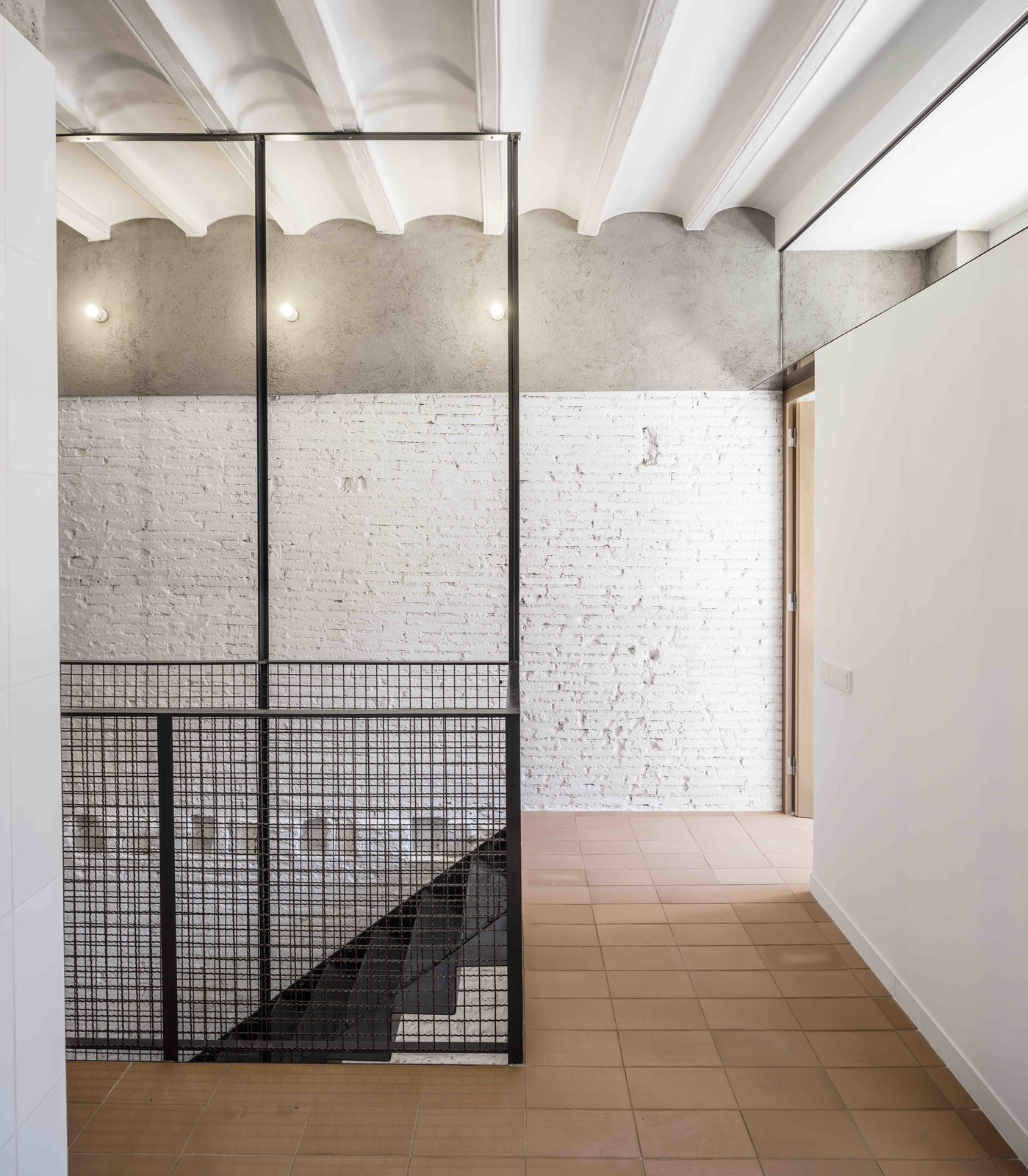 Hallway  Photo 7 of 13 in This Double-Height Apartment in   Barcelona Features Historic Details and a Floating Staircase
