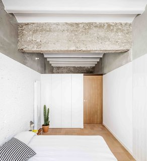 This Double-Height Apartment in   Barcelona Features Historic Details and a Floating Staircase - Photo 7 of 12 -