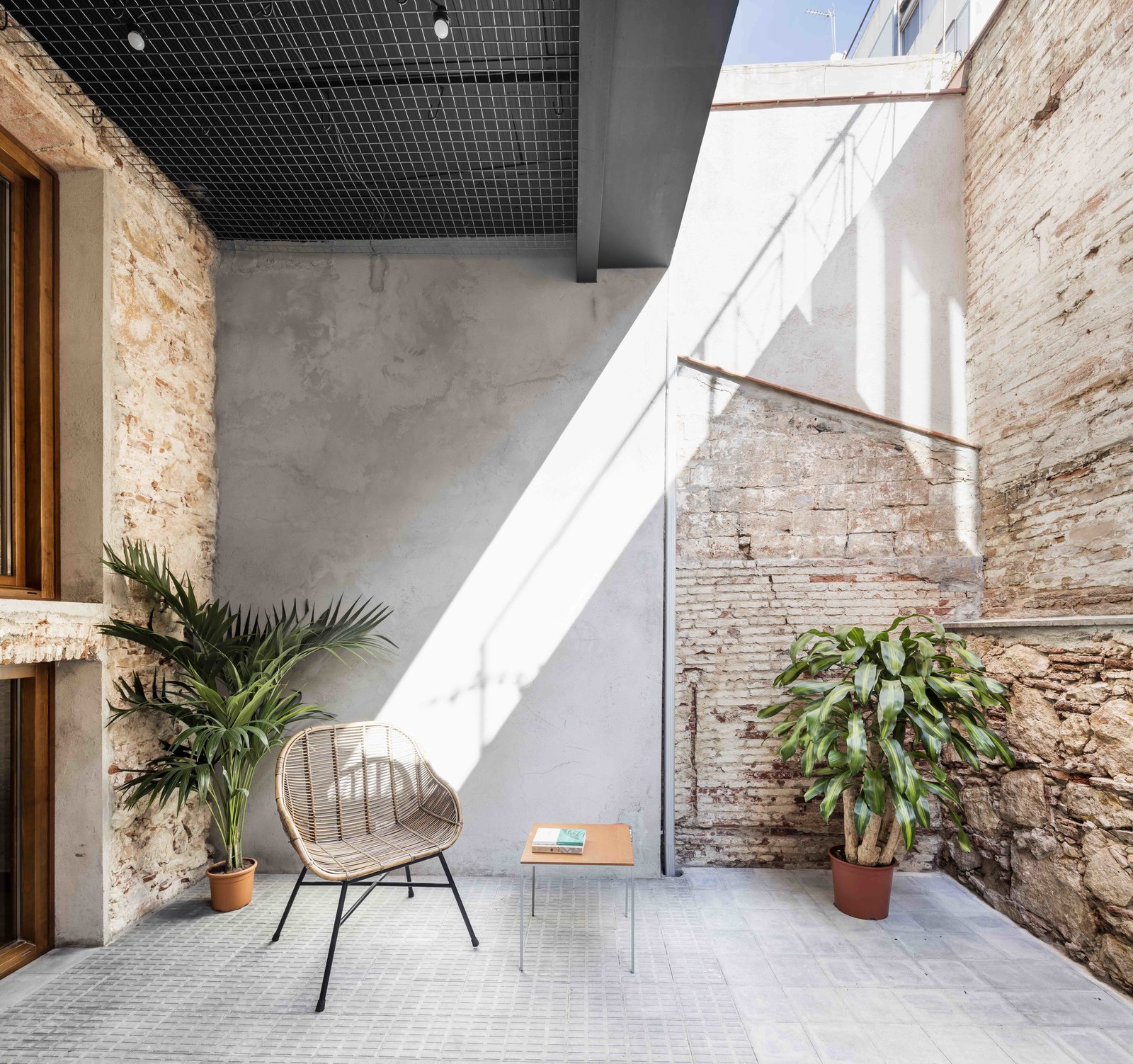 Outdoor, Tile Patio, Porch, Deck, Back Yard, and Small Patio, Porch, Deck  Photo 9 of 13 in This Double-Height Apartment in   Barcelona Features Historic Details and a Floating Staircase