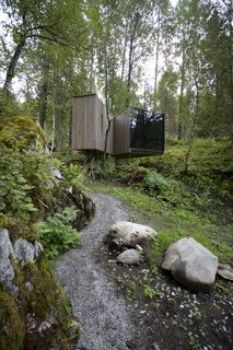A celebration of nature in Norway, this rural hotel marries modern architecture with stunning natural landscapes. All of the hotel's seven rooms, which are built into the landscape, are unique and offer views of the valley, river, courtyard, or a dramatic gorge.