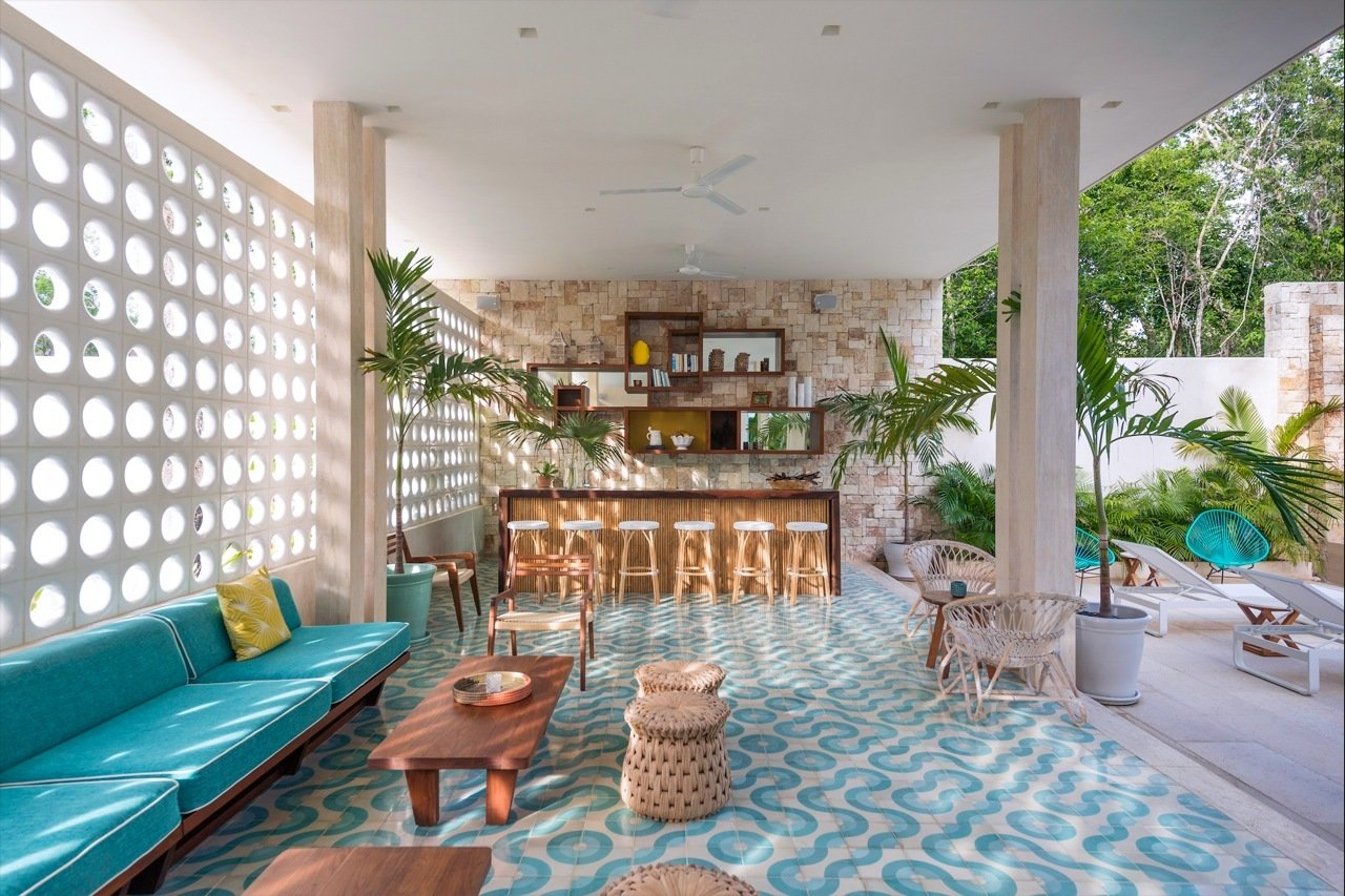 Inspired by Midcentury Miami architecture, this hotel located within a yoga retreat community center known as Holistika Tulum is a retro jungle oasis with cool custom-made floor tiles, rattan chairs and a calming aquamarine color scheme.  Photo 2 of 7 in 7 Modern Hotels in Mexico You Have to Visit