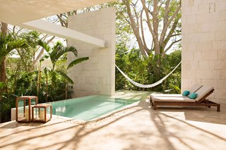 A 19th-century estate in the Yucatán jungle was given new life as a modern Mexican hotel with villa-style abodes, bath tubs made from polished rock, and casitas with their own pool and outdoor showers.