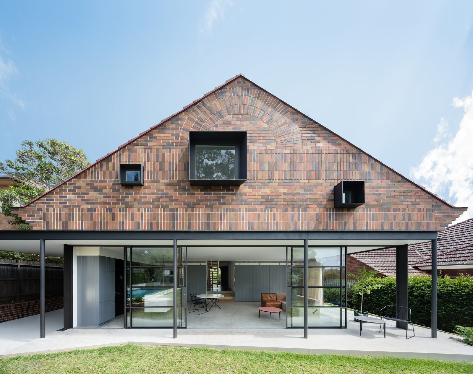 Bricks in five different colors, with alternating horizontal and vertical layouts create a visually captivating façade in this 1930s renovated bungalow in Sydney.  Photo 4 of 10 in 10 Modern Structures That Use Brick in Interesting Ways
