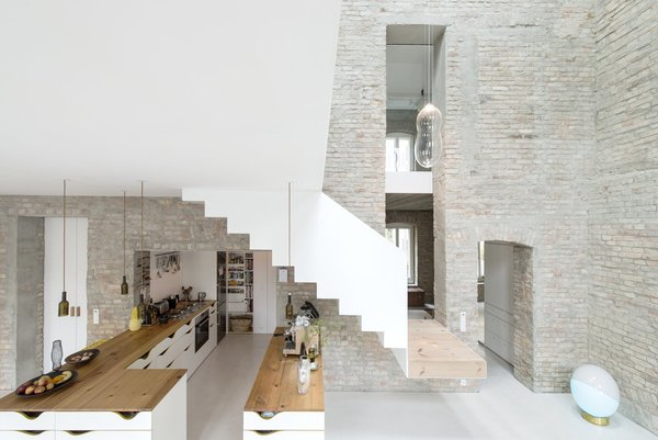 In this 1844 historical renovation in the neighborhood of Prenzlauer Berg in Berlin, the original brick walls of the house were left exposed to pay homage to the property's rustic legacy as the home of a town miller.  Photo 5 of 10 in 10 Modern Structures That Use Brick in Interesting Ways