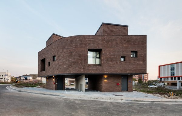 This Korean home has a brick façade and interior walls that omit vertical construction joints, and instead comprise for bricks stacked with an outward twist, which gives the façade a snake scale or bark-like appearance.  Photo 7 of 10 in 10 Modern Structures That Use Brick in Interesting Ways
