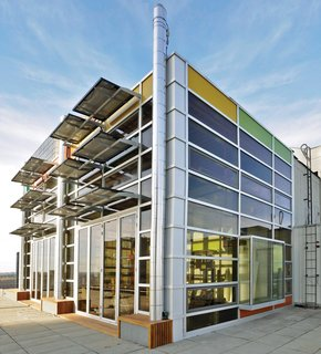 Designed for close to net-zero energy consumption, architect Vivian Manasc's colorful rooftop penthouse in Edmonton, Canada, is equipped with solar panels that generate electricity. Waste heat emissions from the elevator core help warm the space passively.