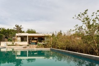 The Mexico City-based architects at Ambrosi | Etchegaray installed a 150,000-liter water tank that holds rainwater in this eco-friendly vacation home in Tepoztlán, Morelos. Solar energy warms the water in the tank when heating is required for the pool and shower water.