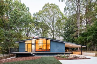 In Situ Studio modernized this 3,400-square-foot home in Raleigh, North Carolina, while preserving its 1959 midcentury roots.