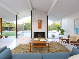 This Orange County Eichler, built in 1962, celebrates the indoor/outdoor, Southern California lifestyle with a skylight atrium, outdoor pool, and plenty of floor-to-ceiling windows.