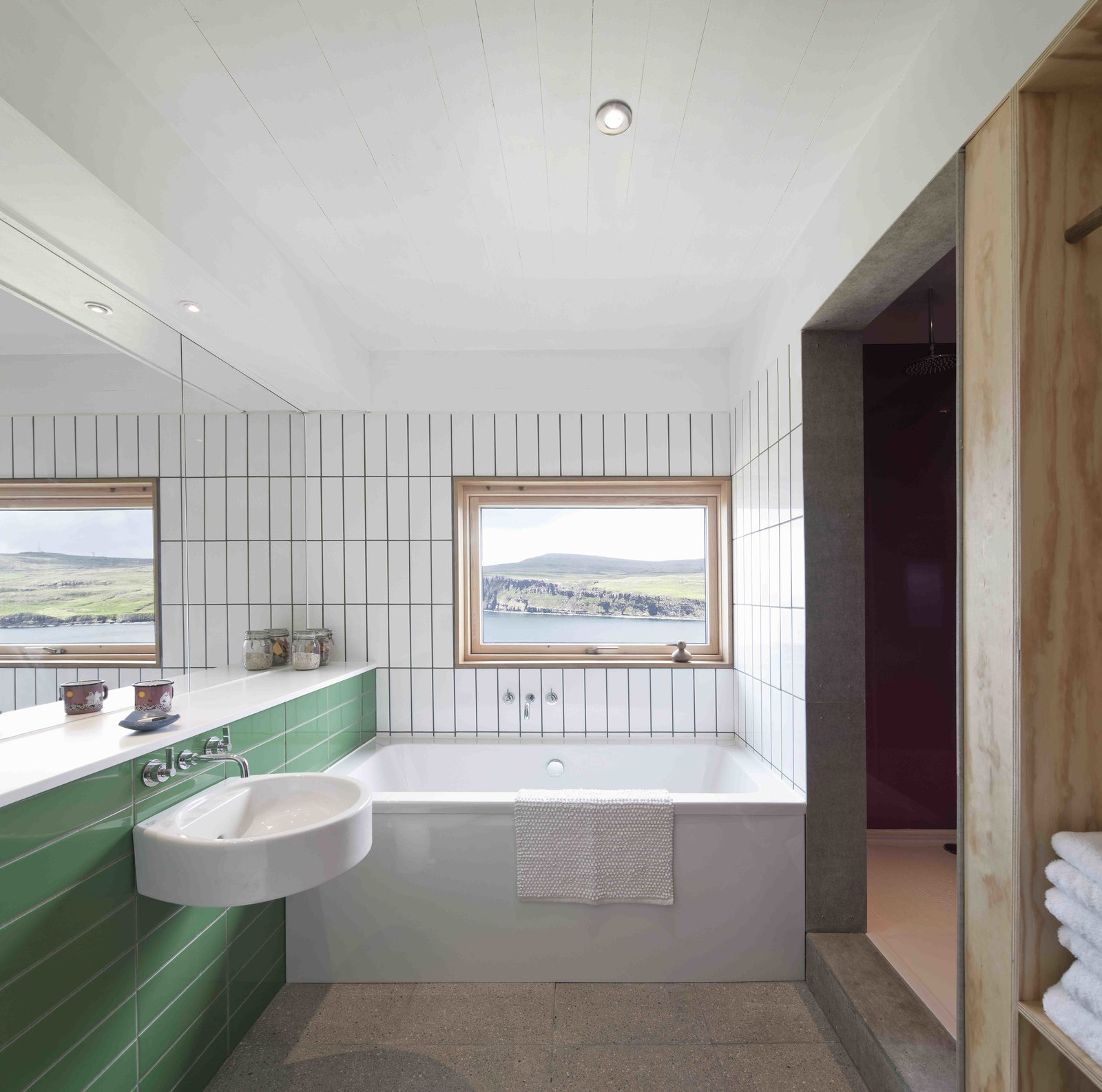 Bath, Ceramic Tile, Alcove, Concrete, Ceiling, and Corner  Best Bath Alcove Ceramic Tile Concrete Photos from Stay in a Modern Tin Cottage on Scotland's Isle of Skye
