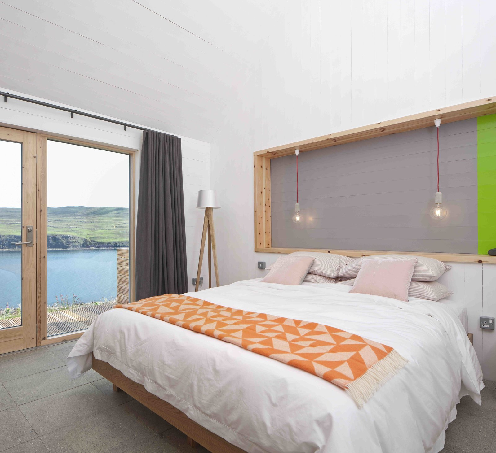 Bedroom, Floor Lighting, Concrete Floor, and Bed  Photo 8 of 11 in Stay in a Modern Tin Cottage on Scotland's Isle of Skye
