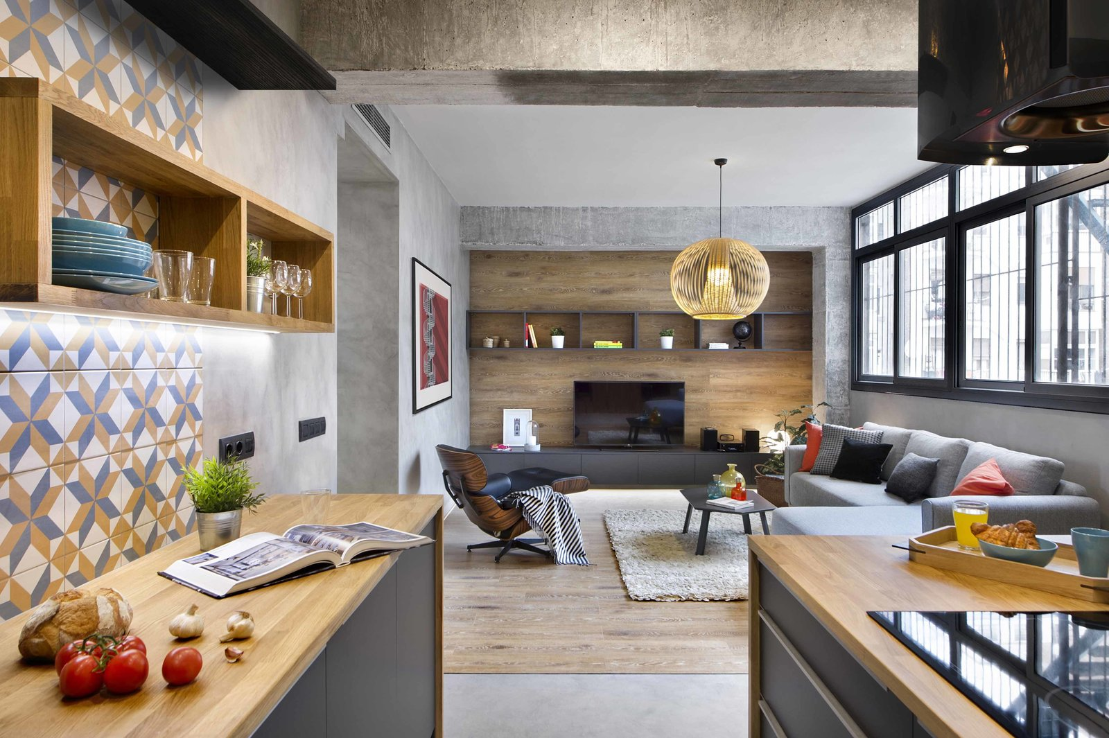 Living, Sofa, Coffee Tables, Media Cabinet, Storage, Shelves, Pendant, Table, Laminate, and Rug  Living Storage Laminate Photos from In This Compact Barcelona Apartment, Space Is Maximized With Smart Material Choices