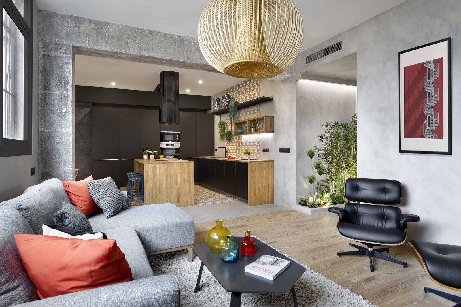 Living, Sectional, Chair, Bar, Stools, Recliner, Pendant, Light Hardwood, Rug, and Ottomans  Best Living Bar Pendant Photos from In This Compact Barcelona Apartment, Space Is Maximized With Smart Material Choices