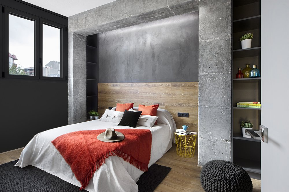 Bedroom, Bed, Night Stands, Storage, Laminate Floor, and Shelves  Photo 9 of 11 in In This Compact Barcelona Apartment, Space Is Maximized With Smart Material Choices