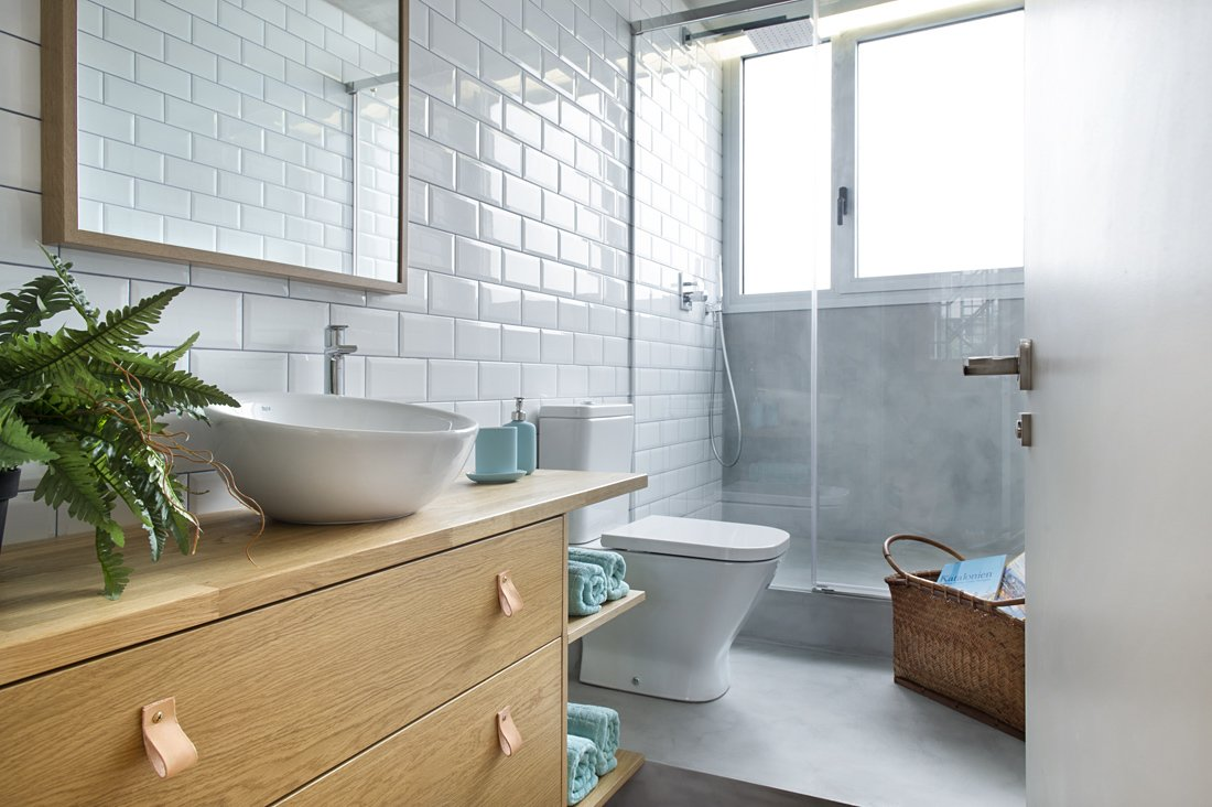 Bath, One Piece, Wood, Concrete, Enclosed, Subway Tile, and Vessel  Best Bath One Piece Vessel Enclosed Photos from In This Compact Barcelona Apartment, Space Is Maximized With Smart Material Choices