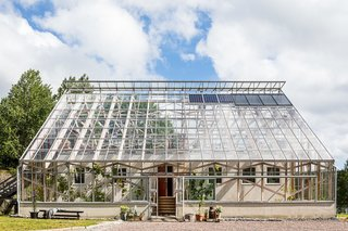 This wood-framed, glass-enclosed lakeside home in Gothenburg, Sweden, looks like a giant greenhouse from the outside, but is in fact a spacious three-bedroom home.