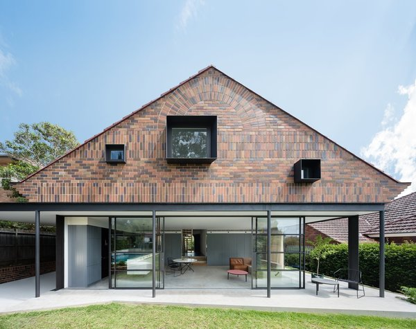 When renovating this 1930s Arts and Crafts-style bungalow in Sydney, TRIBE Studio Architects used vertically and horizontally stacked bricks in three different shades to create an interesting, modern facade at the garden-facing rear of the property.