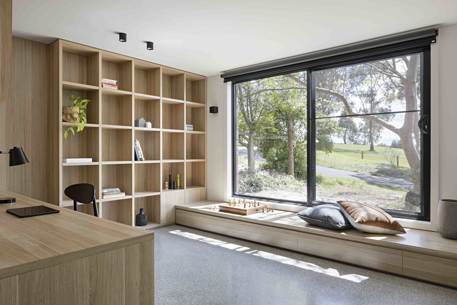 Office, Library Room Type, Study Room Type, Chair, Storage, Shelves, Desk, Bookcase, and Lamps  Photo 8 of 17 in A Remodel Turns a Dark and Choppy House in Melbourne Into a Bright, Flexible Family Home