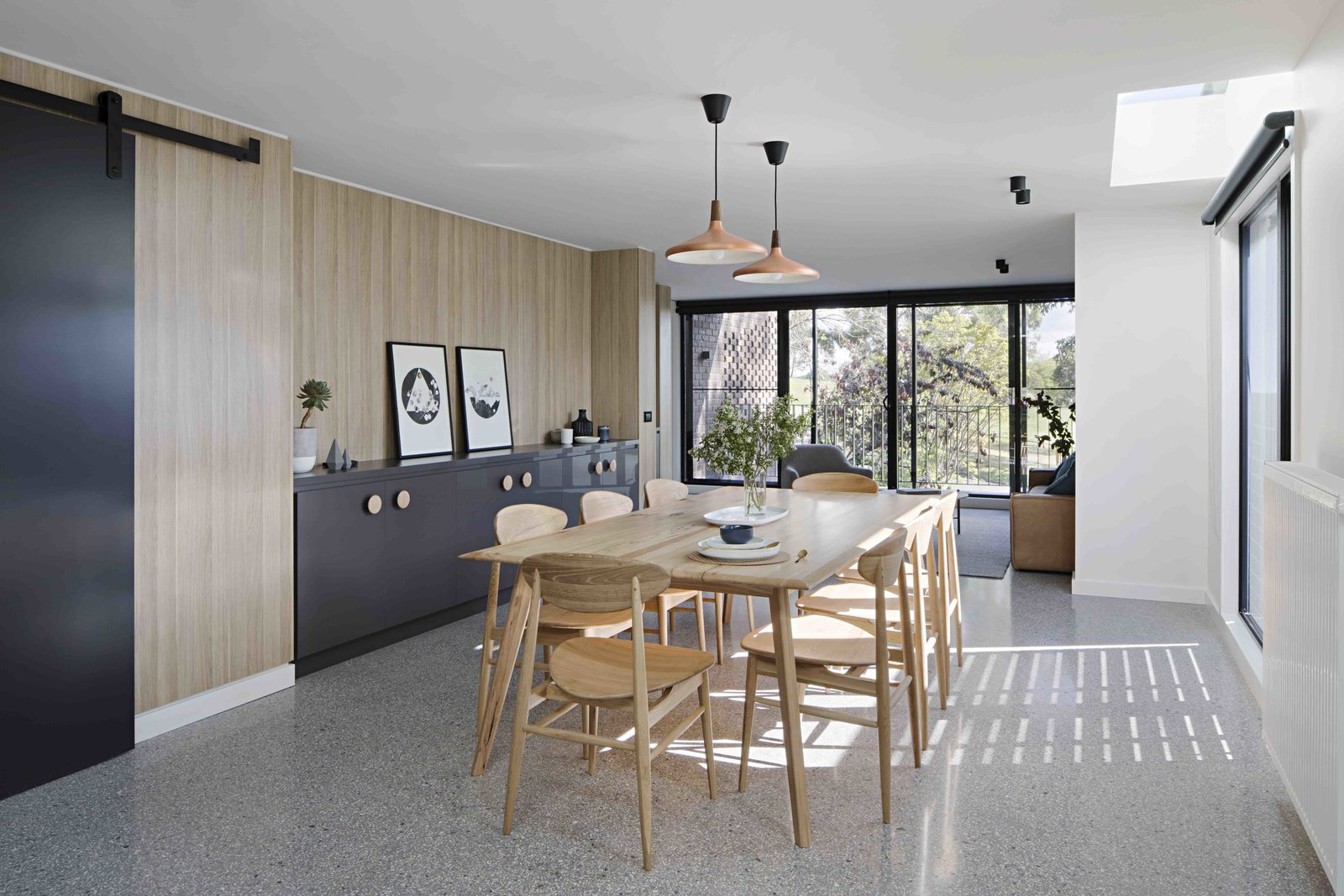 Dining Room, Table, Chair, Storage, Pendant Lighting, and Ceiling Lighting  Photo 16 of 17 in A Remodel Turns a Dark and Choppy House in Melbourne Into a Bright, Flexible Family Home