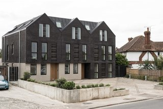 Located on the site of demolished old bungalows, Haddo Yard in Whitstable now consists of seven newly built apartments developed by Arrant Land and designed by celebrated UK practice Denizen Works. The building's facade has dark brick gables that echo the black timber sea fronts of fishing huts found in this part of Kent.