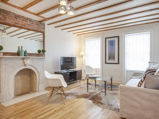 Combining modern decor with historic elements like a 19th-century marble fireplace, this two-bedroom brownstone apartment in Brooklyn's Park Slope neighborhood offers easy access to the borough's many restaurants.