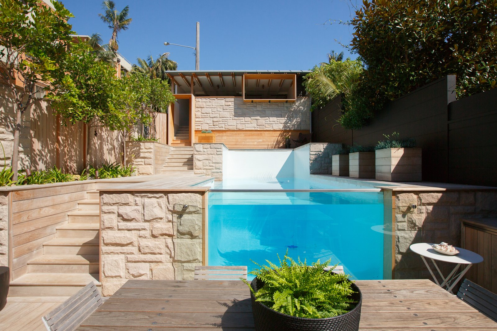 Plans For a Simple Carport Evolve Into a Rear Addition and See-Through Pool