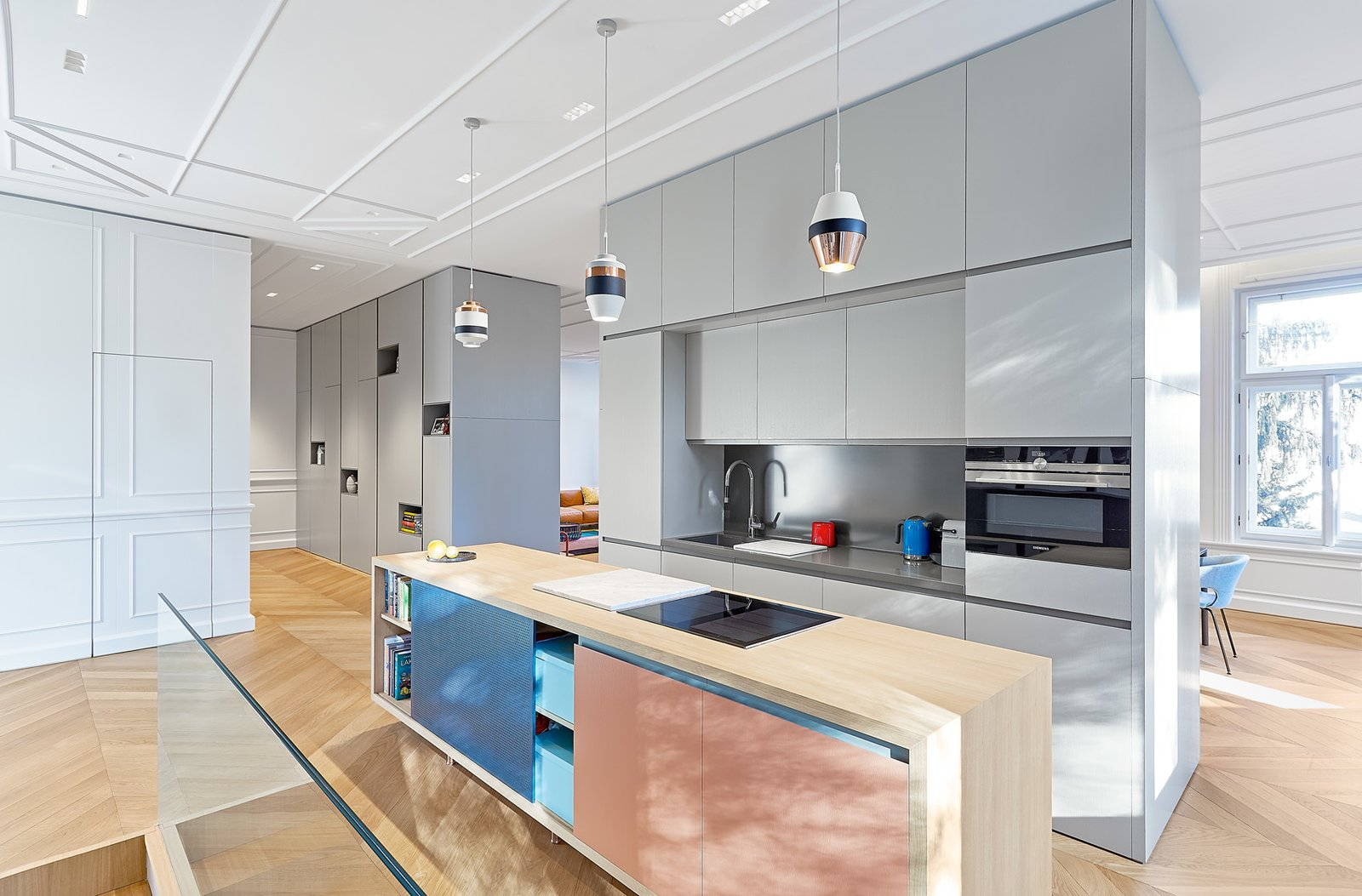 Kitchen, Colorful, Light Hardwood, Pendant, Recessed, Wall Oven, Range, and Drop In  Best Kitchen Recessed Drop In Colorful Photos from A Family Villa in Budapest With Colorful, 1960s-Inspired Interiors