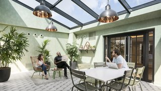 As a company that knows the importance of feeling at home, Airbnb's Paris office was inspired by the city's attic lofts and includes a solarium and roof garden.