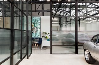 A dynamic warehouse conversion in Melbourne, Victoria, Australia, allows two creative businesses to share a boardroom and break area in a homey, Art Deco-inspired space. Once a manufacturing hub, Cremorne in Melbourne's inner-city has seen an influx of start-ups and creative companies setting up shop, giving new life to the area's factories, warehouses, and Victorian cottages.