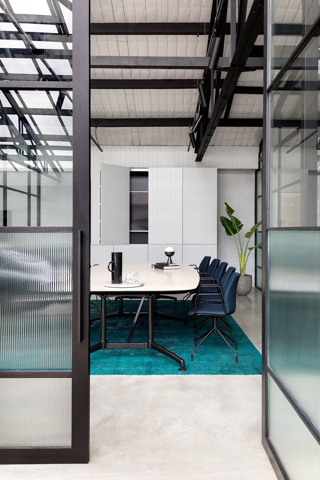 Office, Study Room Type, Chair, Storage, Concrete Floor, and Rug Floor  Photo 11 of 14 in An Art Deco Warehouse in Melbourne Is Converted Into a Shared Office Space