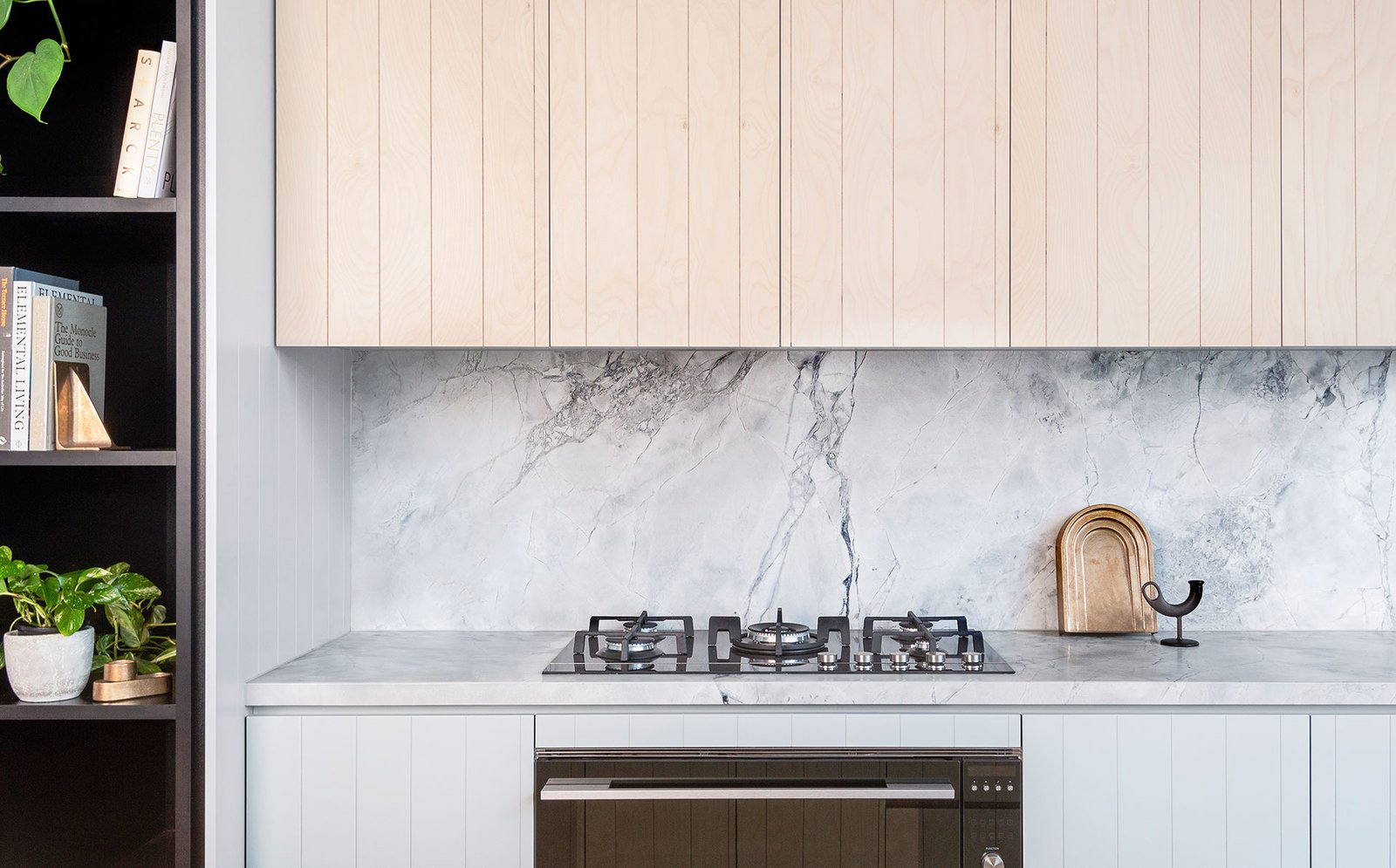 Kitchen, Marble Counter, Marble Backsplashe, White Cabinet, Range, and Wall Oven  Photo 13 of 14 in An Art Deco Warehouse in Melbourne Is Converted Into a Shared Office Space
