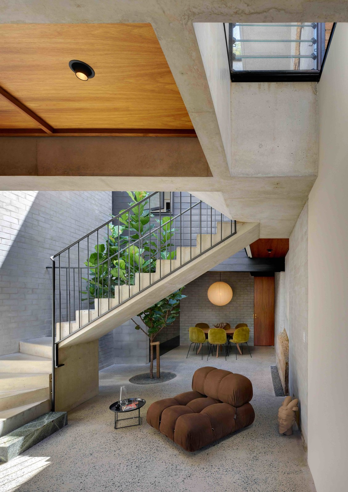 Chair, End Tables, Skylight, Metal, Staircase, Metal, and Concrete  Staircase Metal Metal Photos from Find Out How Light and Precious Outdoor Space Were Introduced to an Old Australian Cottage