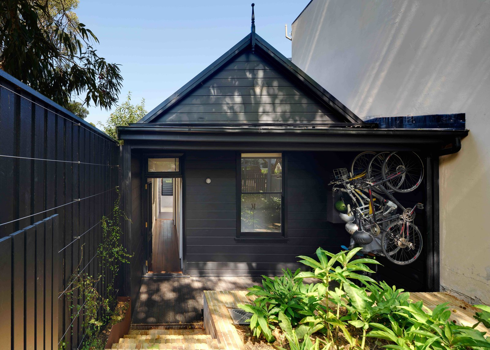 Exterior, Shingles Roof Material, Wood Siding Material, and House Building Type  Photo 14 of 17 in Find Out How Light and Precious Outdoor Space Were Introduced to an Old Australian Cottage