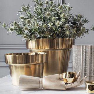 Brass has become a popular choice for contemporary interiors and works particularly well for Scandinavian-inspired concepts. Swedish designer Monica Förster's Brushed Brass Flower Pots for Skultana elevate the traditional terra-cotta pot with a brushed brass that has a high sheen.