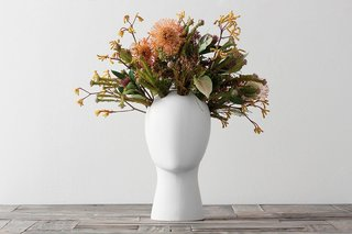 Inspired by Amedeo Modigliani portraits, the glazed ceramic Wig Flower Vase by designer Tania da Cruz is a great addition to your dressing, dining, or side table, and a guaranteed conversation piece.