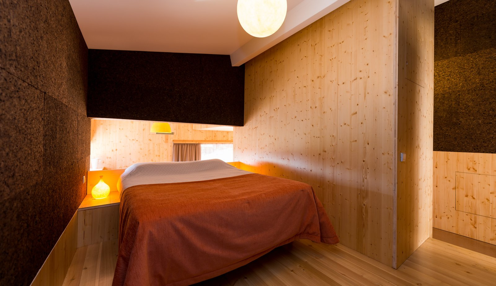 Bedroom, Bed, Night Stands, Ceiling Lighting, Table Lighting, Accent Lighting, Light Hardwood Floor, and Lamps  Photo 8 of 16 in Stay in a Tiny, Eco-Friendly House in a Portuguese Schist Village