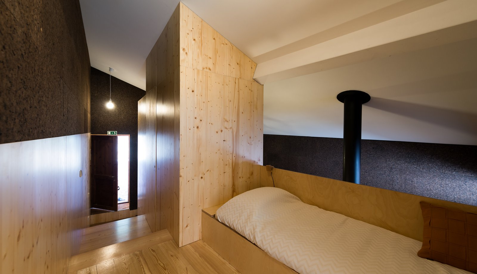 Bedroom, Bed, Pendant Lighting, and Light Hardwood Floor  Photo 10 of 16 in Stay in a Tiny, Eco-Friendly House in a Portuguese Schist Village